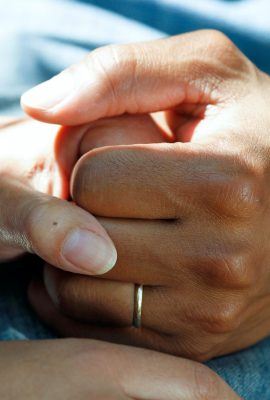 Image of doctor holding hands with patient